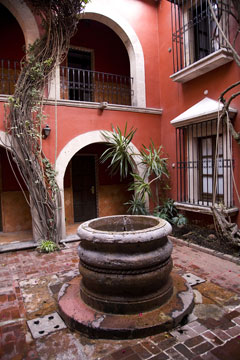 spanish style courtyard and well in mexico